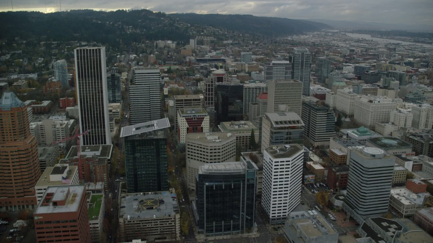 6K stock footage aerial video flying over downtown skyscrapers, and tilt to the roof of 1000 Broadway in Downtown Portland, Oregon Aerial Stock Footage | AX155_071