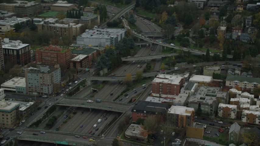 6K stock footage aerial video of I-405 freeway and overpasses beside Portland State University in Downtown Portland, Oregon Aerial Stock Footage | AX155_072