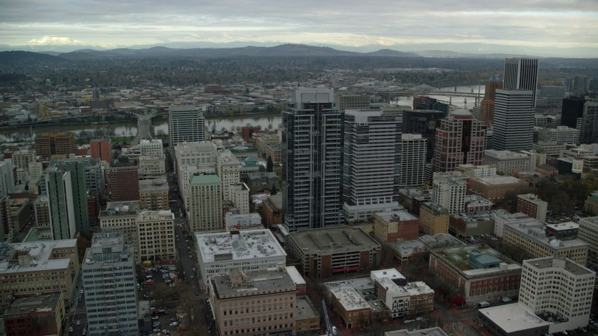6K stock footage aerial video flying over Park Avenue West Tower, and tilt to reveal Pioneer Courthouse Square in Downtown Portland, Oregon Aerial Stock Footage | AX155_075