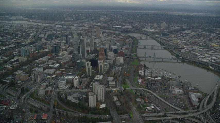 6K stock footage aerial video approaching Downtown Portland cityscape and the Willamette River in Oregon Aerial Stock Footage | AX155_082