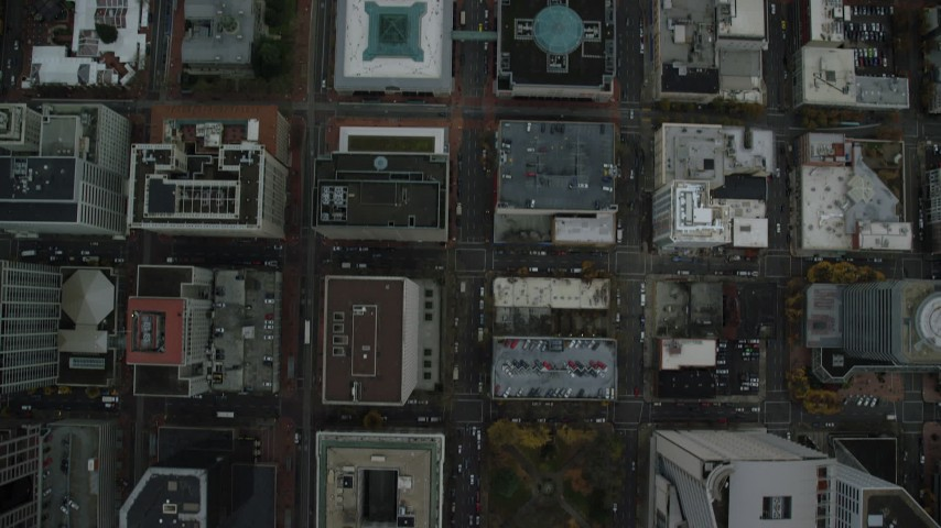 6K stock footage aerial video of a bird's eye view of city streets, revealing a shopping mall and US Bancorp Tower in Downtown Portland, Oregon Aerial Stock Footage | AX155_085