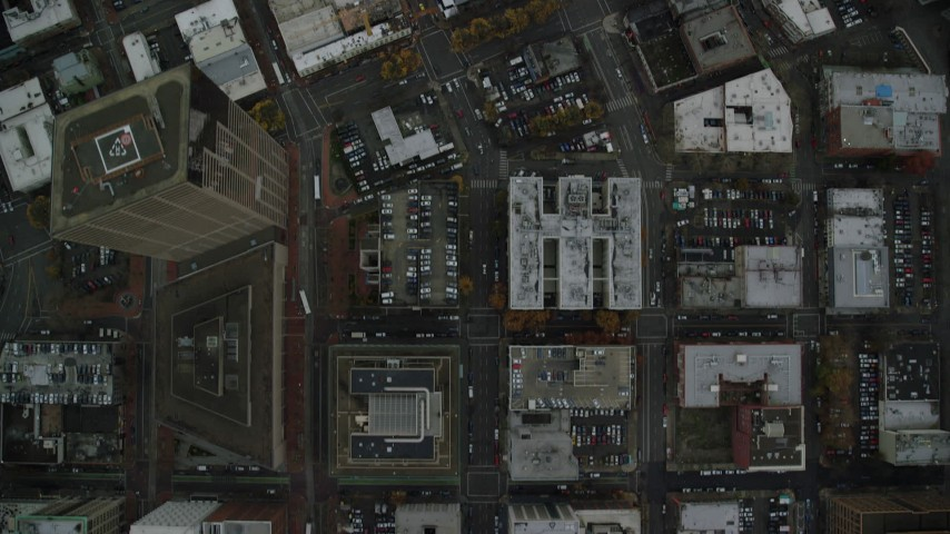 6K stock footage aerial video of a bird's eye view of city streets, US Bancorp Tower, and buildings in Downtown Portland, Oregon Aerial Stock Footage | AX155_086