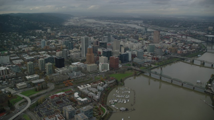 6K stock footage aerial video of a view of Downtown Portland cityscape and waterfront park seen from the bridges over the Willamette River in Oregon Aerial Stock Footage | AX155_094