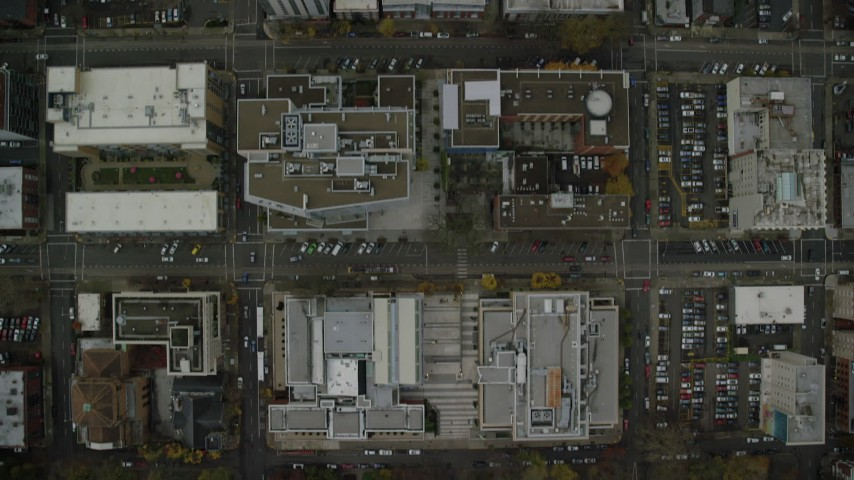 6K aerial video of a bird's eye view of city streets and buildings in Downtown Portland, Oregon, and reveal the I-405 freeway Aerial Stock Footage | AX155_099
