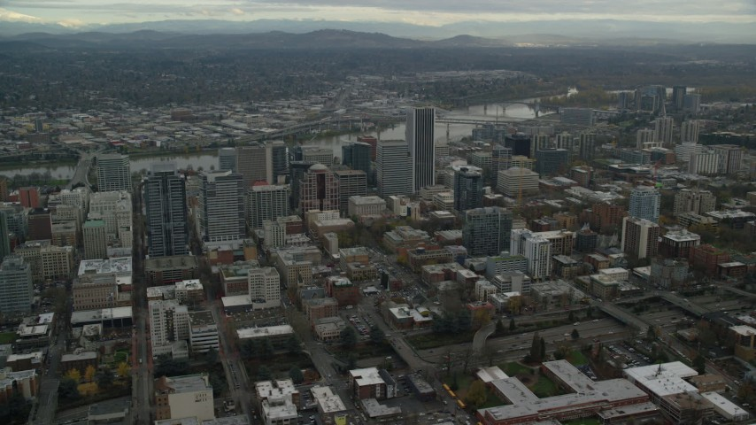 6K stock footage aerial video orbiting the Downtown Portland cityscape with Willamette River behind it in Oregon Aerial Stock Footage | AX155_100