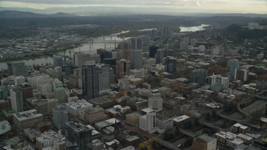 6K stock footage aerial video orbiting the Downtown Portland cityscape with Willamette River behind it in Oregon Aerial Stock Footage | AX155_101