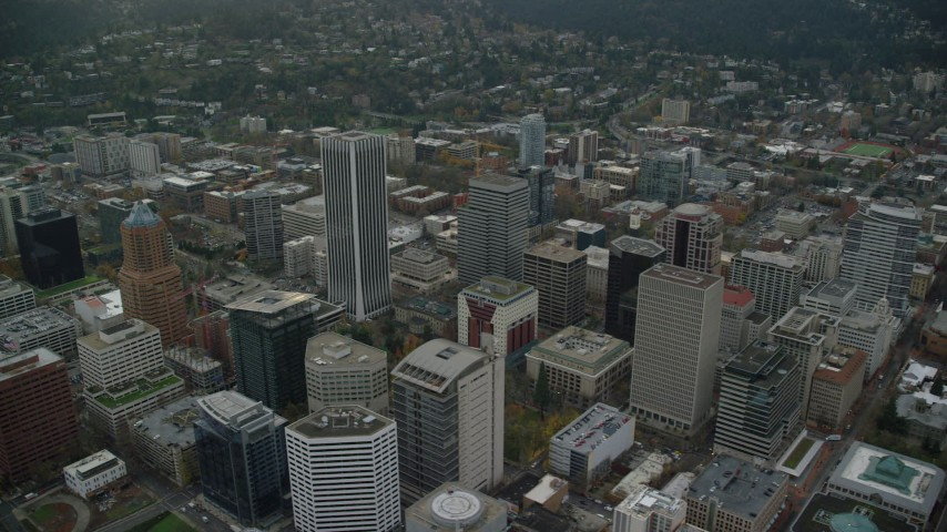 6K stock footage aerial video orbiting KOIN Center, Wells Fargo Center, PacWest Center, Portland City Hall, and high-rises in Downtown Portland, Oregon Aerial Stock Footage | AX155_105