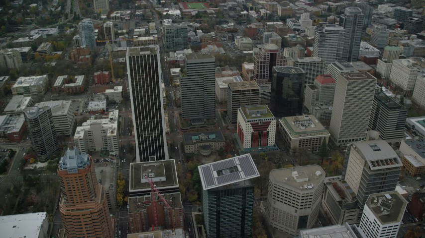 6K stock footage aerial video orbiting Wells Fargo Center, Portland City Hall, and parks in Downtown Portland, Oregon Aerial Stock Footage | AX155_106