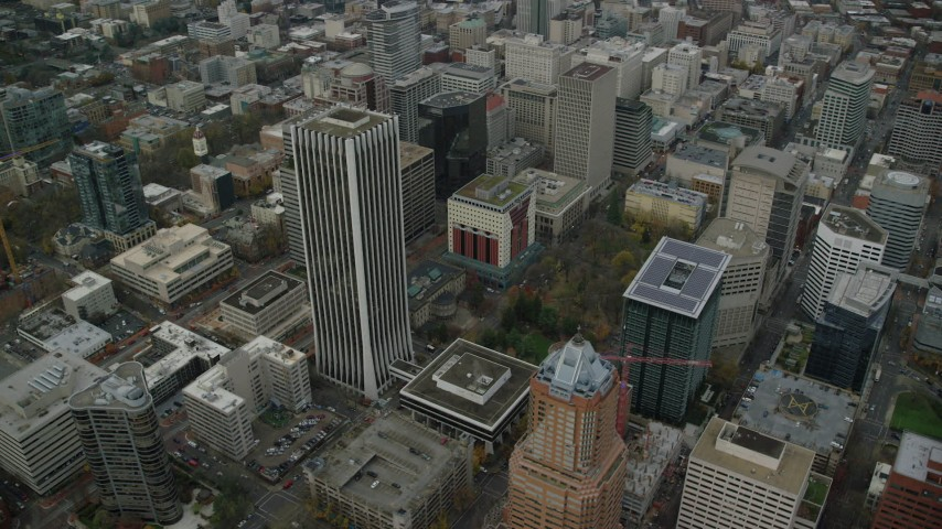6K stock footage aerial video orbiting Wells Fargo Center, parks, and KOIN Center in Downtown Portland, Oregon Aerial Stock Footage | AX155_107
