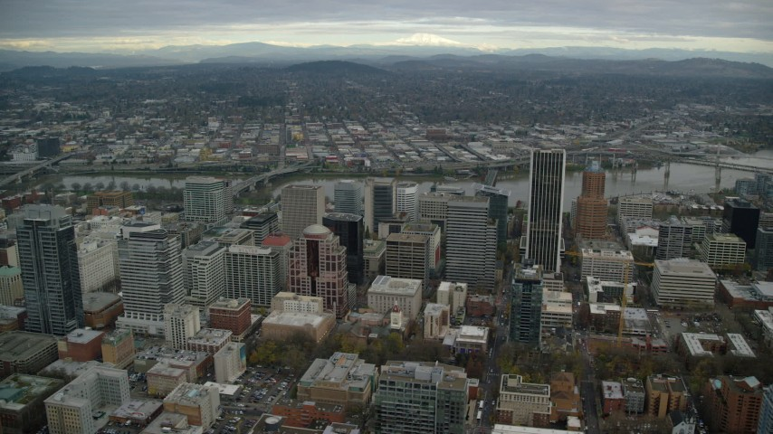 6K stock footage aerial video flying by skyscrapers and high-rises near the Willamette River in Downtown Portland, Oregon Aerial Stock Footage | AX155_110