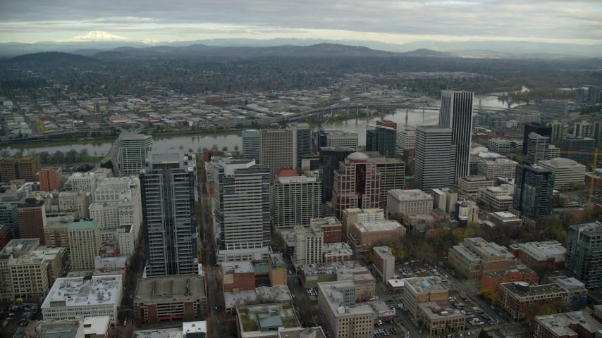 6K stock footage aerial video orbiting skyscrapers and high-rises around Park Avenue West Tower near the Willamette River in Downtown Portland, Oregon Aerial Stock Footage | AX155_111