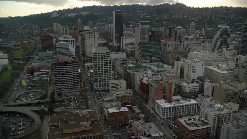 6K stock footage aerial video orbiting high-rises and skyscrapers in Downtown Portland, Oregon Aerial Stock Footage | AX155_114