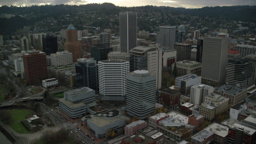 6K stock footage aerial video orbiting high-rises and near KOIN Center in Downtown Portland, Oregon Aerial Stock Footage | AX155_115