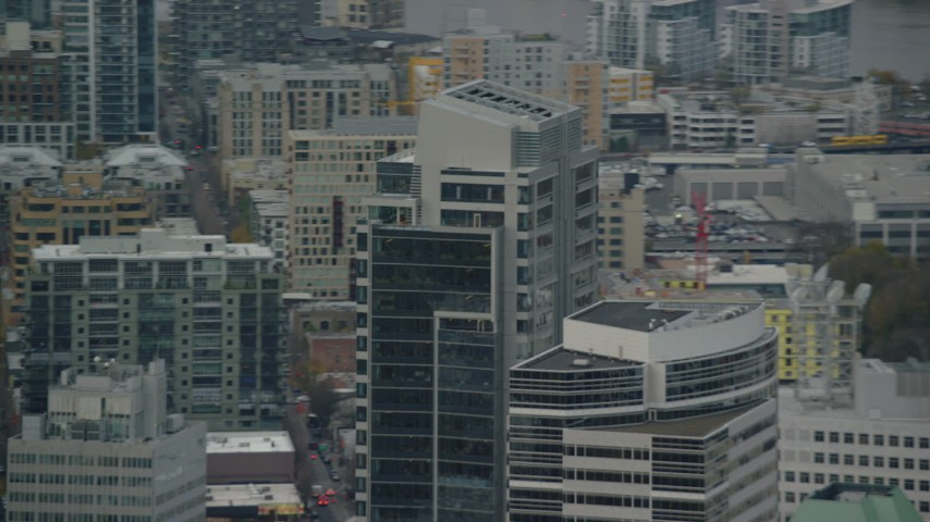 6K aerial video tracking the tops of Park Avenue West Tower and Fox Tower in Downtown Portland, Oregon Aerial Stock Footage   AX155_117