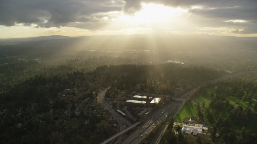 6K stock footage aerial video of godrays shining down on suburban neighborhoods and Highway 26, Southwest Portland, Oregon Aerial Stock Footage | AX155_119