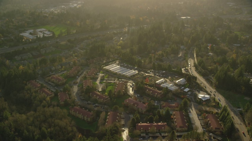 6K stock footage aerial video flying by apartments and greenhouses in Southwest Portland, Oregon Aerial Stock Footage | AX155_120