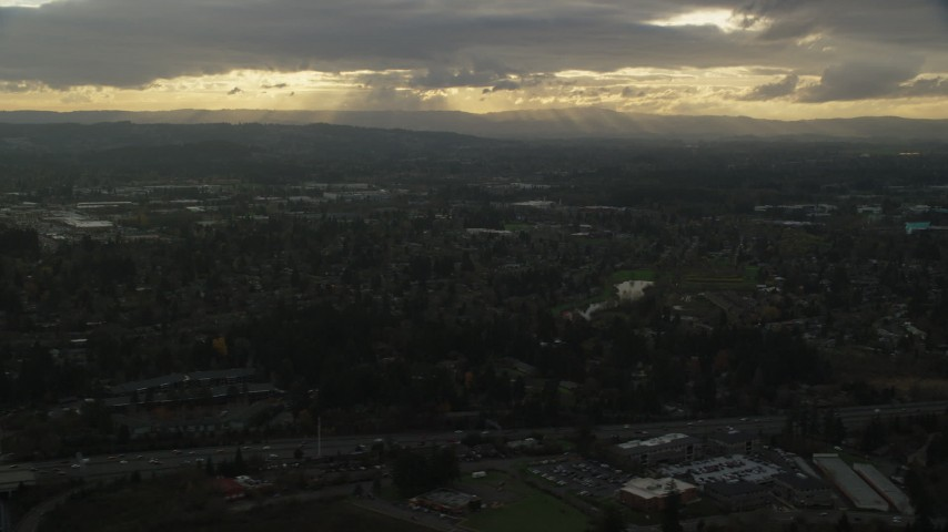 6K stock footage aerial video flying by suburban neighborhood with a lot of trees in Beaverton, Oregon, sunset Aerial Stock Footage | AX155_123