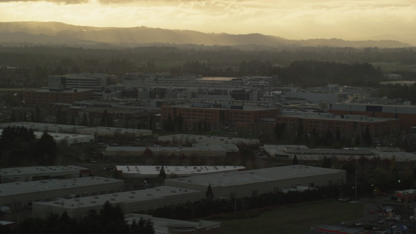 6K stock footage aerial video of Intel Ronler Acres with godrays in the background, in Hillsboro, Oregon, sunset Aerial Stock Footage | AX155_130