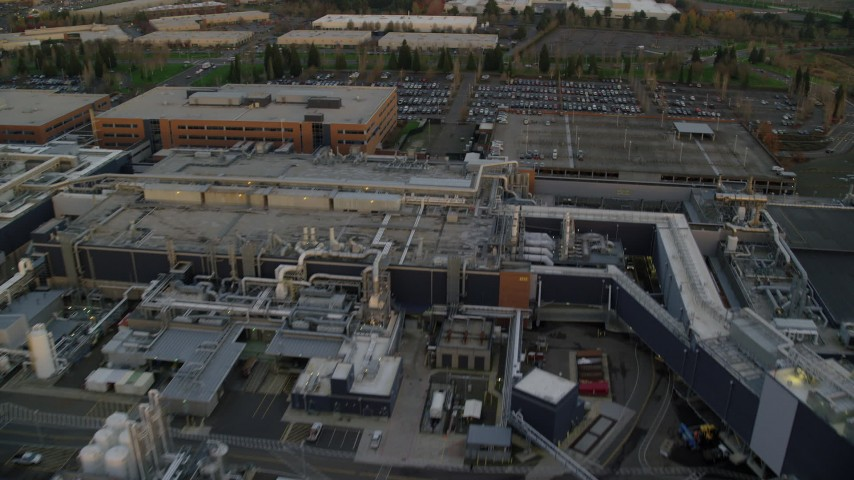 6K stock footage aerial video flying over Intel Ronler Acres Campus at twilight to approach and fly over warehouse buildings, in Hillsboro, Oregon Aerial Stock Footage   AX155_133