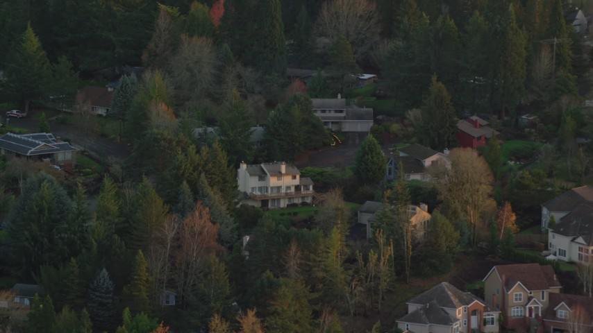6K stock footage aerial video flying by suburban homes on a cul-de-sac at twilight in Hillsboro, Oregon Aerial Stock Footage | AX155_135