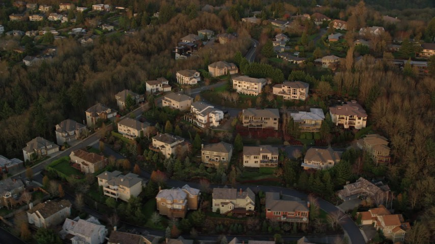 6K stock footage aerial video flying by large hillside homes in Northwest Portland, Oregon Aerial Stock Footage | AX155_138