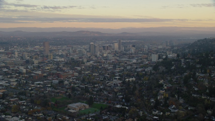 6K stock footage aerial video of Downtown Portland skyscrapers at twilight, seen from Northwest Portland, Oregon Aerial Stock Footage | AX155_142