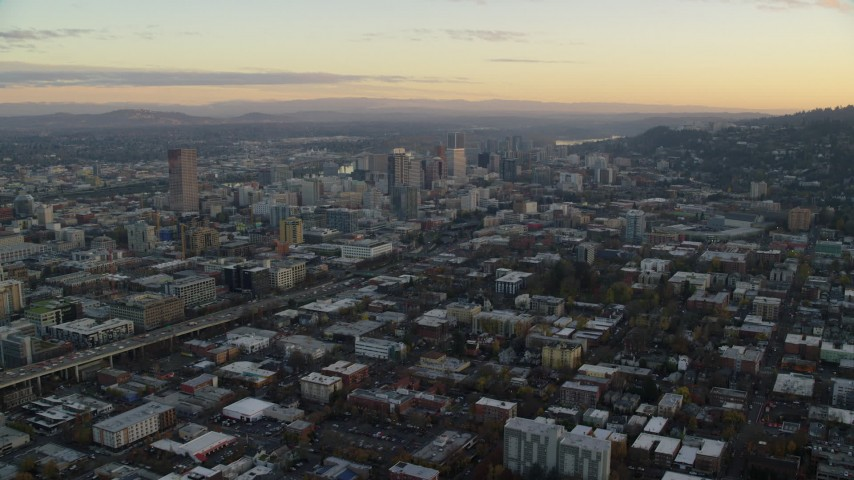 6K stock footage aerial video approaching Providence Park near I-405 and Downtown Portland, Oregon, twilight Aerial Stock Footage | AX155_144