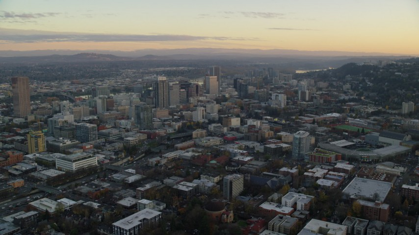 6K stock footage aerial video passing by skyscrapers at twilight in Downtown Portland, Oregon Aerial Stock Footage | AX155_145