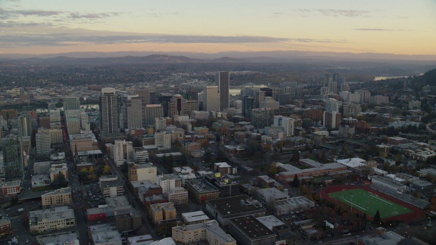 6K stock footage aerial video flying  by skyscrapers at twilight in Downtown Portland, Oregon Aerial Stock Footage | AX155_146