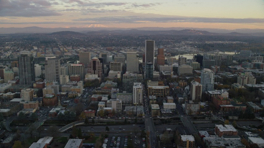 6K stock footage aerial video flying by skyscrapers and high-rises at twilight in Downtown Portland, Oregon Aerial Stock Footage | AX155_147