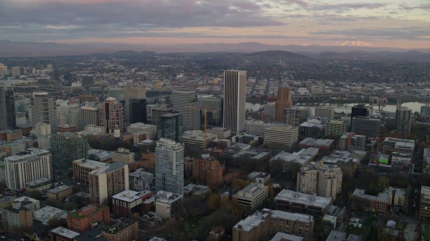 6K stock footage aerial video orbiting skyscrapers and high-rises at twilight in Downtown Portland, Oregon Aerial Stock Footage | AX155_148