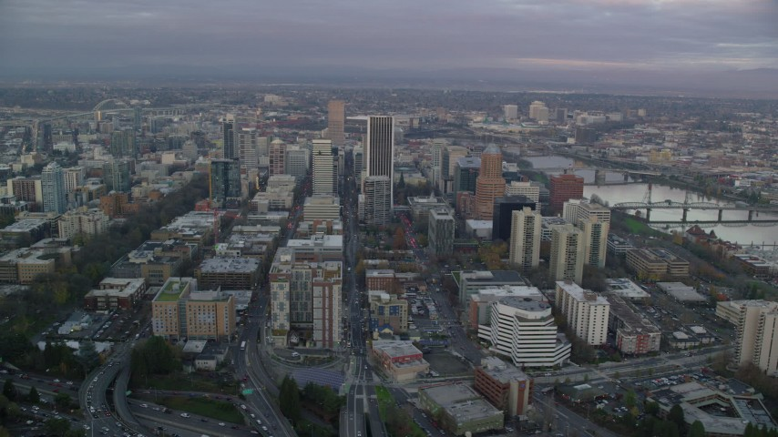 6K stock footage aerial video orbiting Downtown Portland, Oregon at twilight, by the Willamette River Aerial Stock Footage | AX155_150