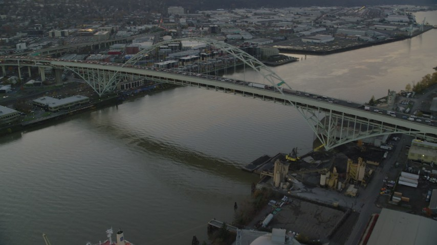 6K stock footage aerial video orbiting heavy traffic crossing the Fremont Bridge at twilight in Downtown Portland, Oregon Aerial Stock Footage | AX155_158