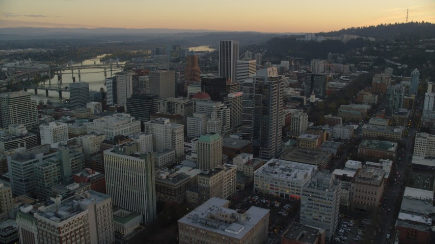 6K stock footage aerial video flying over Park Avenue West Tower at twilight to approach KOIN Center and Wells Fargo Center in Downtown Portland, Oregon Aerial Stock Footage | AX155_165