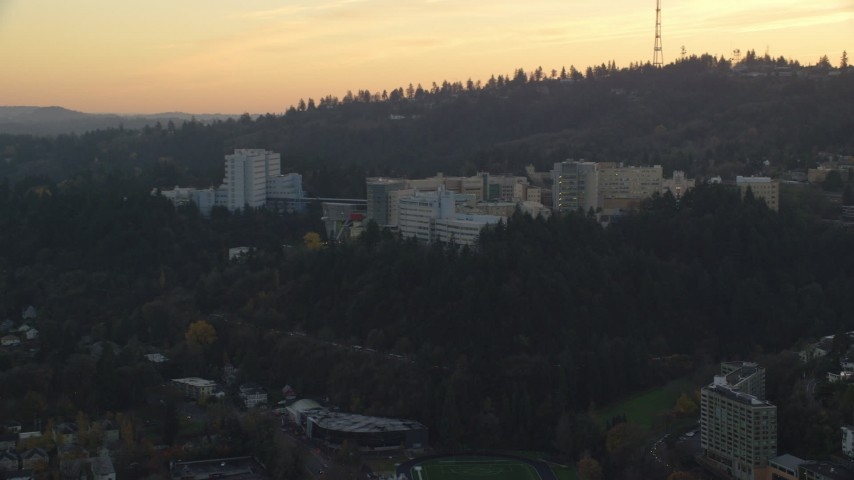 6K stock footage aerial video of the Oregon Health and Science University in Portland, Oregon, twilight Aerial Stock Footage | AX155_167