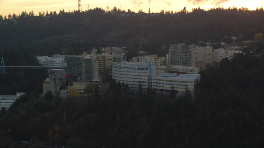 6K aerial video flying by Oregon Health and Science University in Portland, Oregon, twilight Aerial Stock Footage | AX155_168