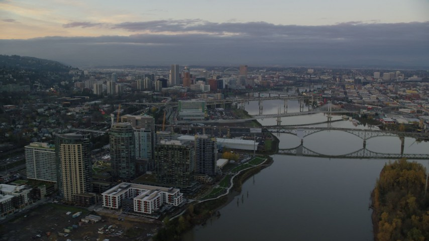 6K stock footage aerial video of Downtown Portland and the Willamette River at sunset, seen from the Ross Island Bridge Aerial Stock Footage | AX155_170