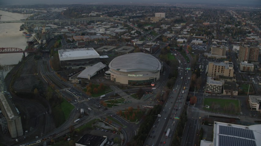 6K stock footage aerial video of I-5, Veterans Memorial Colosseum, Moda Center, and convention center in Lloyd District, Portland, Oregon, twilight Aerial Stock Footage | AX155_176