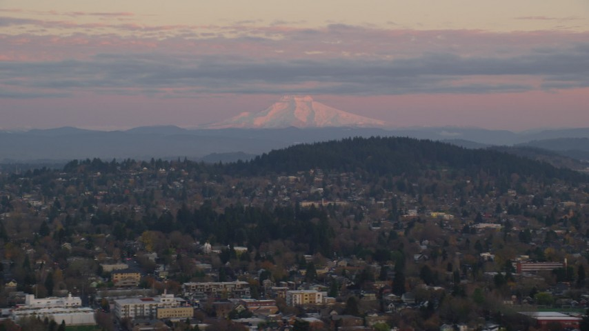 6K stock footage aerial video of Northeast Portland neighborhoods with Mount Hood in the distance at twilight, Oregon Aerial Stock Footage | AX155_177