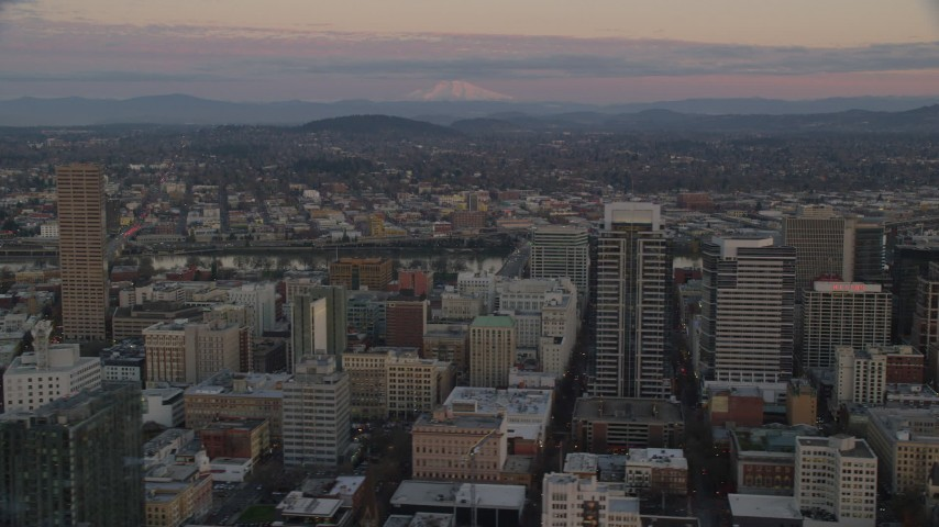 6K stock footage aerial video of Mount Hood seen from US Bancorp Tower at twilight in Downtown Portland, Oregon Aerial Stock Footage | AX155_181