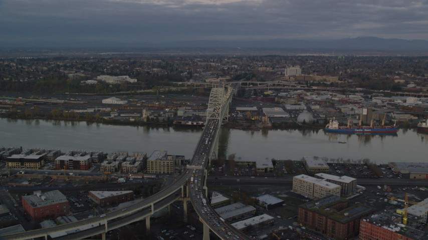 6K stock footage aerial video orbiting the Fremont Bridge with very heavy traffic at twilight, Portland, Oregon Aerial Stock Footage | AX155_182