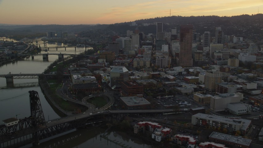 6K stock footage aerial video of Downtown Portland skyscrapers seen from Willamette River at twilight in Oregon Aerial Stock Footage | AX155_186