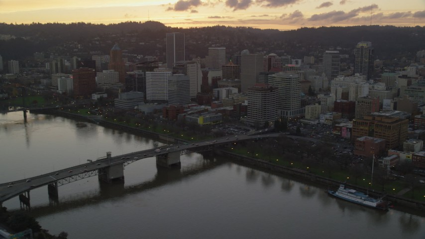 6K stock footage aerial video of Hawthorne Bridge, Morrison Bridge, and Downtown Portland at twilight, Oregon Aerial Stock Footage | AX155_188