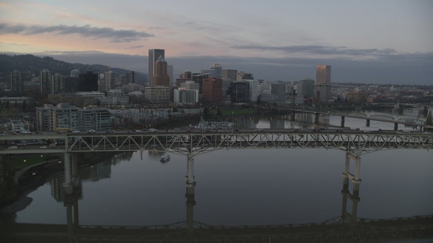 6K stock footage aerial video flying over Marquam Bridge, approach marina, Hawthorne Bridge, and downtown skyline at twilight, Downtown Portland, Oregon Aerial Stock Footage | AX155_201