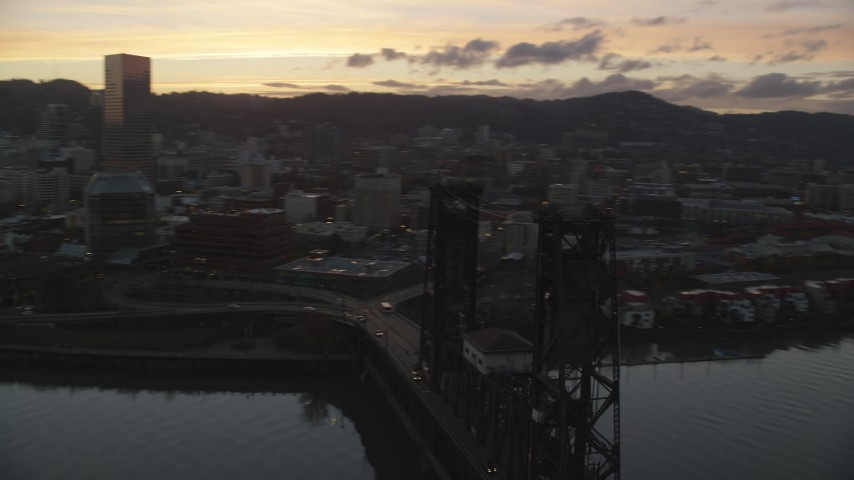 6K stock footage aerial video of US Bancorp Tower at twilight, seen from the Steel Bridge, Downtown Portland, Oregon Aerial Stock Footage | AX155_206