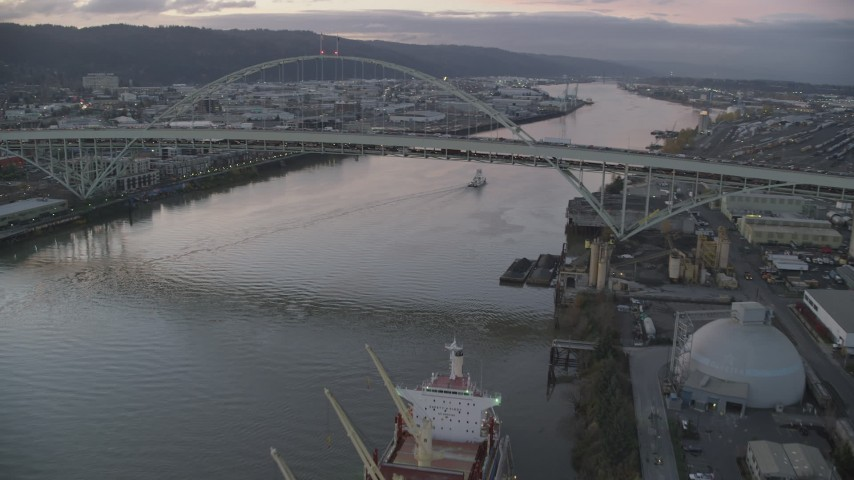 6K stock footage aerial video approaching and flying by heavy traffic on both decks of the Fremont Bridge, twilight, Portland, Oregon Aerial Stock Footage | AX155_208