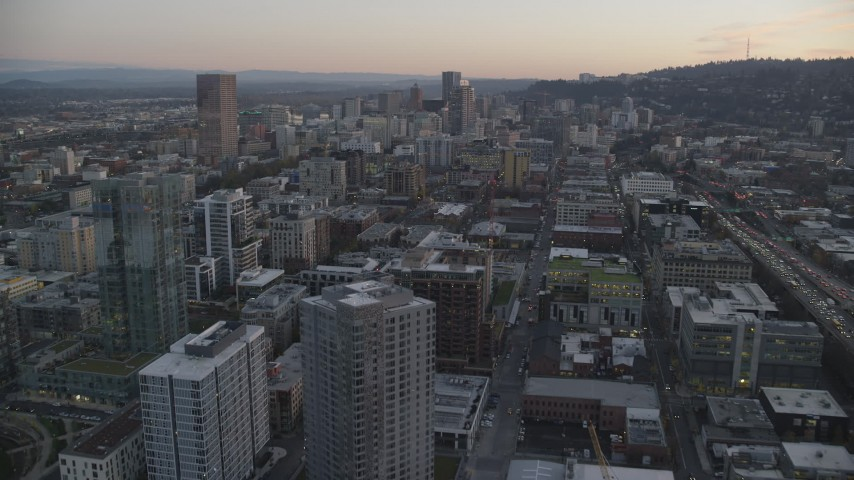 6K stock footage aerial video flying over downtown buildings to approach US Bancorp Tower, North Park Blocks, and high-rises, Downtown Portland, Oregon, twilight Aerial Stock Footage | AX155_212