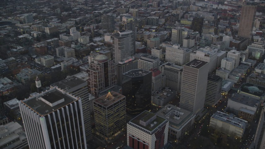 6K stock footage aerial video flying over 1000 Broadway, Fox Tower, and Park Avenue West Tower at twilight, Downtown Portland, Oregon Aerial Stock Footage | AX155_216