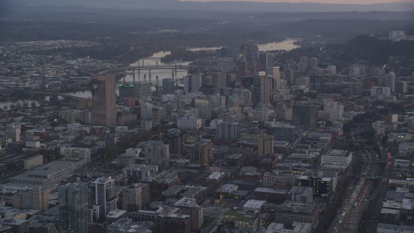 6K stock footage aerial video of Downtown Portland cityscape by the Willamette River at twilight, Oregon Aerial Stock Footage | AX155_218