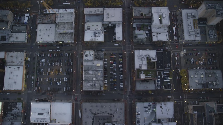 6K stock footage aerial video of a bird's eye view of NW and 5th and 6th Avenue at twilight, reveal US Bancorp Tower, Downtown Portland, Oregon Aerial Stock Footage | AX155_222
